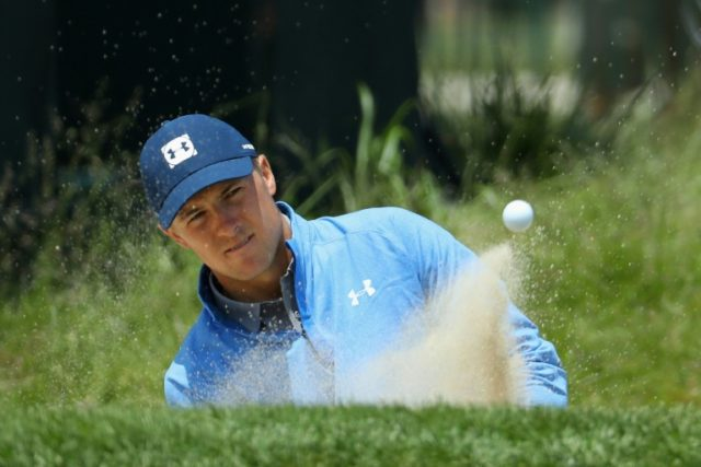 Jordan Spieth of the United States plays a shot from a bunker during practice rounds prior to the 2018 US Open
