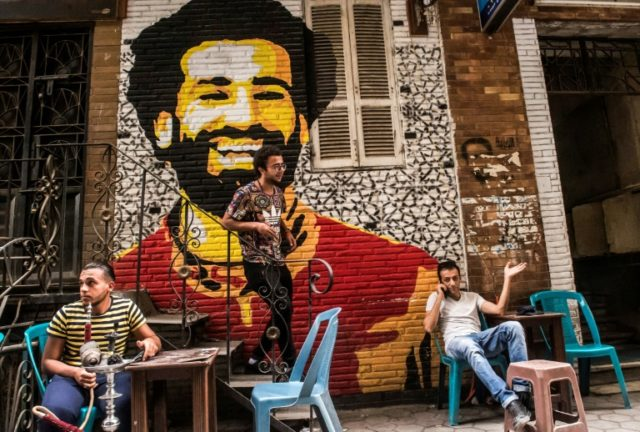 A mural on a cafe in Cairo shows Egypt star Mohamed Salah, who eager fans are hoping to see as the national team makes its first World Cup appearance in 28 years