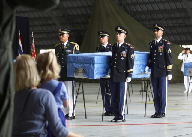 In this photo from 2000, honor guards carry the remains of a US service member being repatriated from North Korea