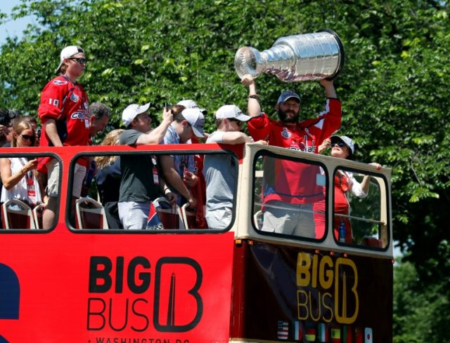 Washington Capitals captain Alex Ovechkin holds up the Stanley Cup during the team's victory parade