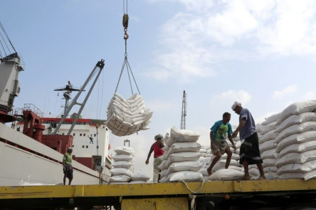 In this file photo taken on January 27, 2018, workers unload wheat assistance provided by UNICEF from a cargo ship in the Red Sea port of Hodeida, a key entry point for United Nations aid to war-torn Yemen