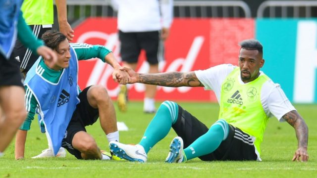 Germany midfielder Mesut Ozil (left) and defender Jerome Boateng take part in training near Moscow
