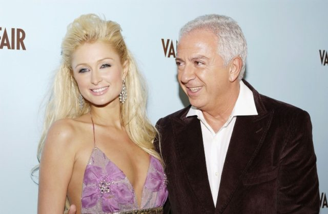 Guess co-founder Paul Marciano, seen here in 2004 with model Paris Hilton, has resigned from his company after sexual assault claims