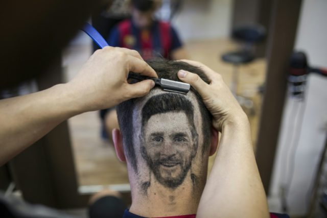 Serbian hairdresser Mario Hvala creates a hair 'tattoo' of Argentinian star Lionel Messi, on June 10 ahead of the World Cup in Russia