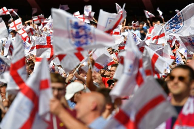 England fans wave flags in the sunshine ahead of the International friendly football match against Nigeria at Wembley stadium in London on June 2, 2018