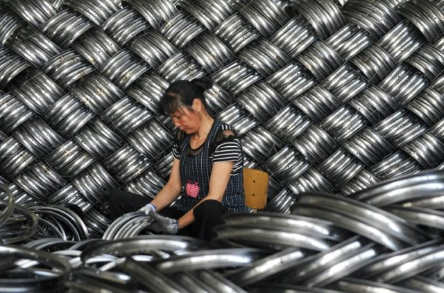 Output growth at Chinese factories and workshops slowed in May and missed forecasts