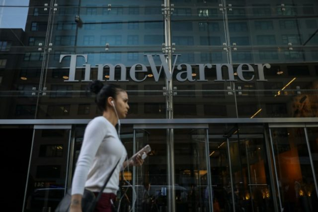 AT&T got a green light from a federal judge to proceed with its takeover of media-entertainment giant Time Warner, whose New York headquarters is seen here