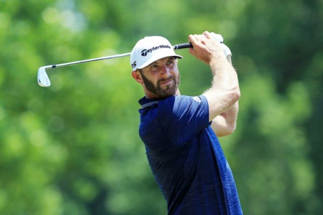 Dustin Johnson plays his shot from the second tee during the final round of the FedEx St. Jude Classic at TPC Southwind in Memphis, Tennessee