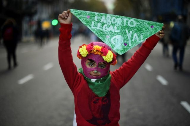 A young girl takes part in a June 2018 march in Buenos Aires against violence towards women and for abortion rights