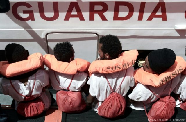 Spain offered to take in the ship Aquarius' 629 rescued migrants, some shown in this handout photo, despite roadblocks from police and conservatives
