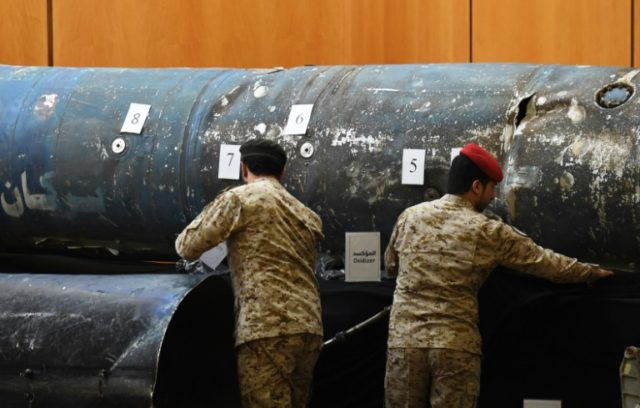 Saudi soldiers reveal the remains of missiles fired from Yemen on the kingdom; a confidential UN report says that debris it examined from five missiles were made in Iran but officials could not determine when they were sent to Yemen