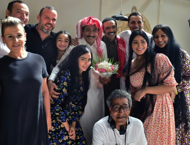 A picture dated November 18, 2016 from the Middle East Broadcasting Center shows Saudi actor Nasser al-Gasabi (C) with the cast and crew of 'Al-Assouf' in Abu Dhabi