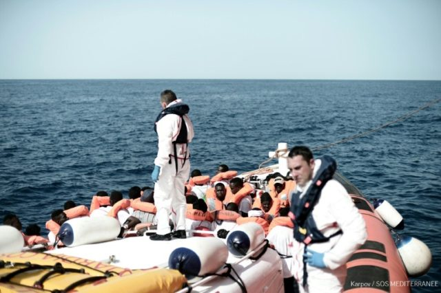 This handout picture from French NGO Doctors Without Borders (MSF) and SOS Mediterranee shows migrants onboard an Italian coastguard ship