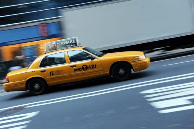 New York transit officials have decided to let taxi drivers, facing severe competition from Uber and Lyft, to continue driving traditional yellow cabs like this one rather than forcing them to switch to a so-called 'Taxi of Tomorrow'
