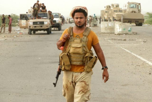 Yemeni pro-government fighters advance south of Hodeida international airport on June 13, 2018