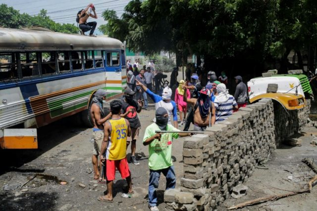 Anti-government demonstrators set up a barricade in Tipitapa, about 25 kilometers (15 miles) from Nicaraguan capital Managua, during a day-long national strike