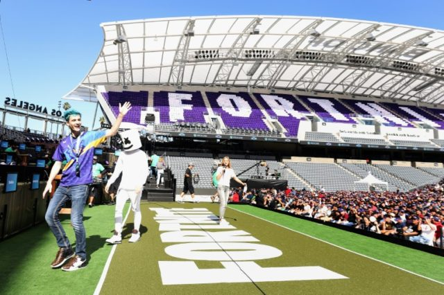 "Video game celebrities ""Ninja"" and ""Marshmello"" walk onstage during the Epic Games Fortnite E3 Tournament at the Banc of California Stadium"