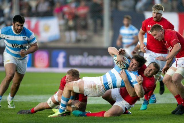 Tomas Lezana (C) of Argentina is tackled by Hadleigh Parkes (bottom-R) of Wales during their int'l Test match at the San Juan del Bicentenario Stadium in San Juan, on June 9, 2018