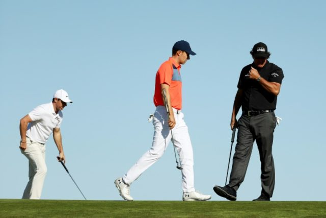 (L-R) Rory McIlroy of Northern Ireland, Jordan Spieth of the United States, and Phil Mickelson of the United States walk up the tenth green during the first round of the 2018 US Open at Shinnecock Hills Golf Club on June 14, 2018