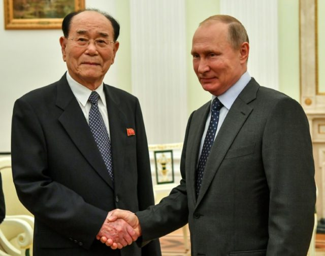President Vladimir Putin shakes hands with Kim Yong Nam, North Korea's ceremonial head of state, at the Kremlin after inviting leader Kim Jong Un to visit Russia