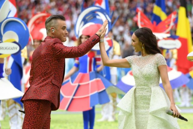 English musician Robbie Williams (L) and Russian soprano Aida Garifullina perform during the World Cup opening ceremony