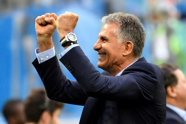 Against the odds: Carlos Queiroz celebrates a famous win for Iran