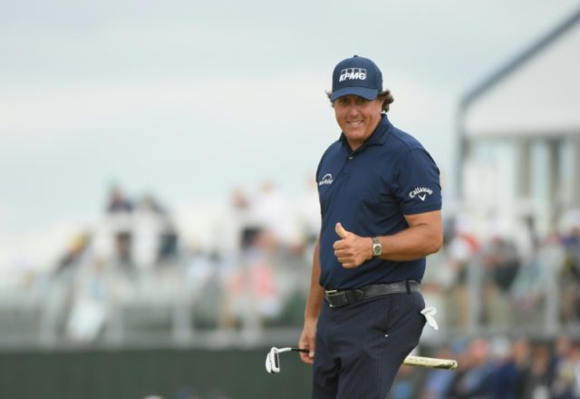 Phil Mickelson will celebrate his 48th birthday playing in the third round at the US OPen after grinding out a second-round 69 to make the cut with two strokes to spare on six-over 146