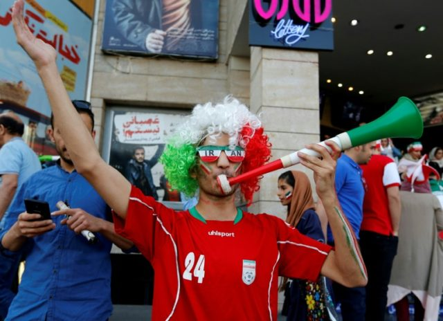 Iranians arrive to watch the World Cup Group B soccer match between Morocco and Iran at Azadi cinema in Tehran on June 15, 2018