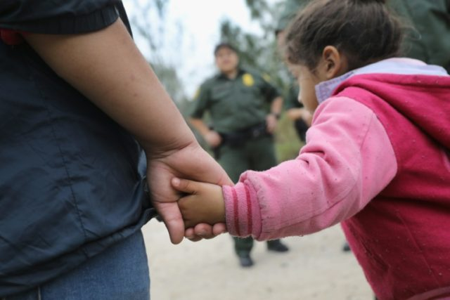 When adults are taken into custody at the US border, as shown here in Texas in 2017, their children are split from them because the children are not themselves charged with a crime