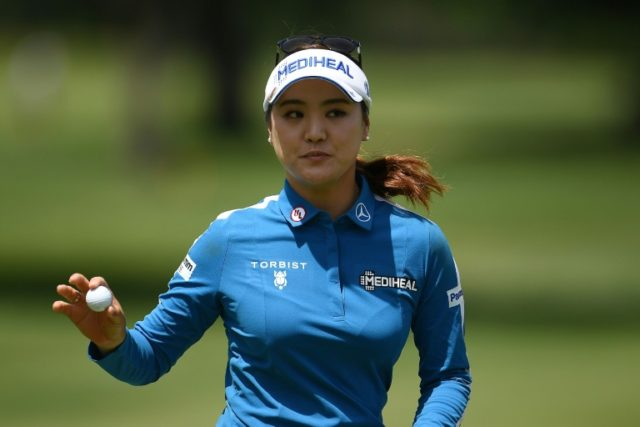 Ryu So-yeon of South Korea waves to the crowd on the 18th green during the first round of the Meijer LPGA Classic, at Blythefield Country Club in Grand Rapids, Michigan, on June 14, 2018