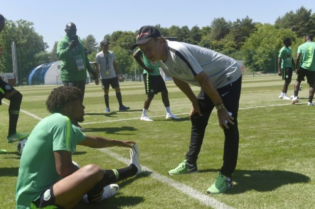 Nigeria coach Gernot Rohr talks to Arsenal forward Alex Iwobi in their World Cup training camp