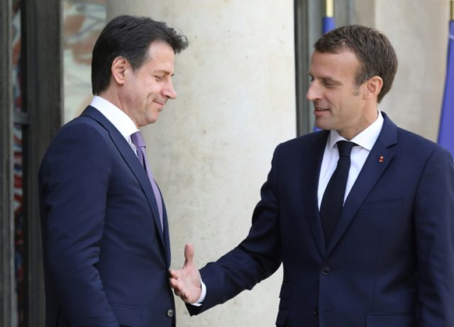 Macron meets Italy PM as migrant crisis splits Europe