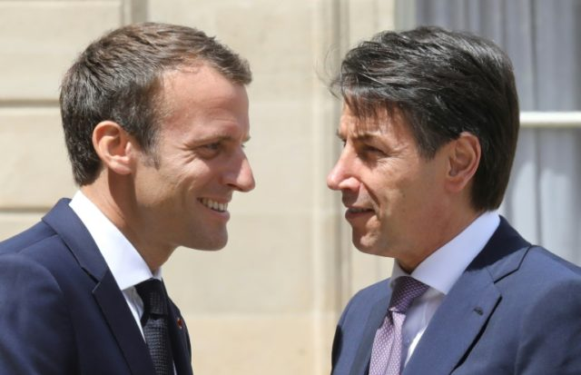 French President Emmanuel Macron and new Italian Prime Minister Giuseppe Conte (R) held talks in Paris calling for EU migrant centres to be set up in countries of origin