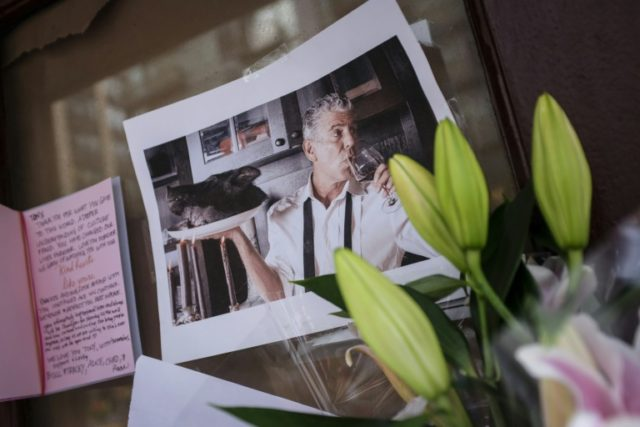 Notes, photographs and flowers are left in memory of Anthony Bourdain at the closed location of Brasserie Les Halles, where Bourdain used to work as the executive chef, June 8, 2018 in New York City