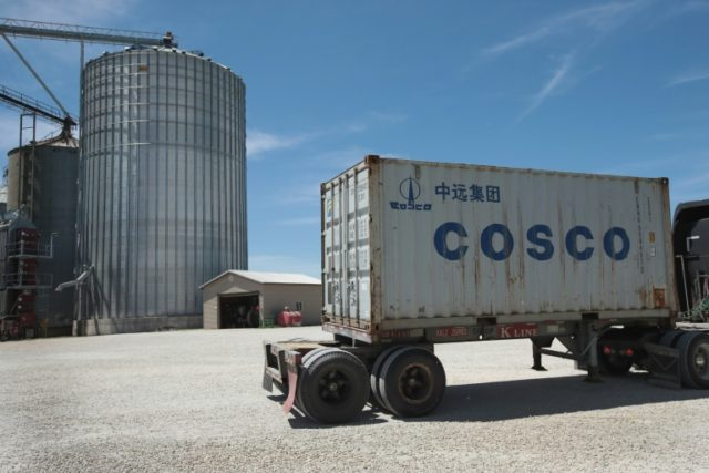 A shipping container is loaded with soybeans at a Ruff Bros. Grain elevator on June 13, 2018 in Blackstone, Illinois; US soybean futures have plunged today on fears of retaliatory measures if the US imposes wide ranging tariffs on Chinese goods