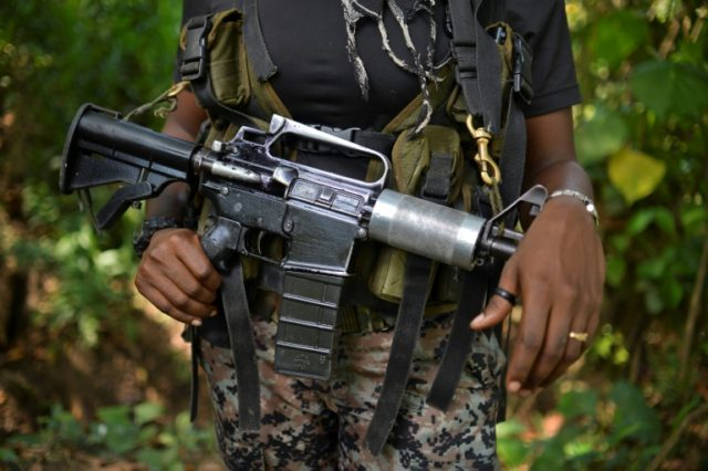 A National Liberation Army (ELN) guerrilla fighter stands guard on January 26, 2017 in Alto Baudo, Colombia