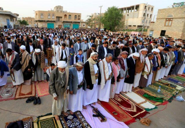 Yemeni worshippers perform Muslim Eid al-Fitr prayers in the capital Sanaa on June 15, 2018