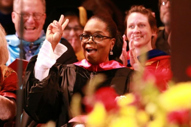 Oprah Winfrey, seen addresssing the USC Annenberg School for Communication and Journalism commencement ceremony in May, has agreed to produce original shows for Apple's new online platform