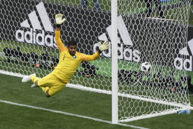 Saudi Arabia's goalkeeper Abdullah Al-Mayouf lets in a Russian goal during the opening match of the World Cup in Moscow on June 14, 2018