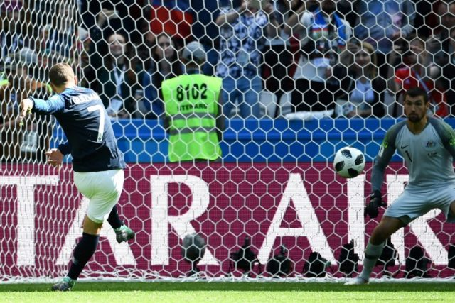 Antoine Griezmann scores the first World Cup penalty awarded through VAR