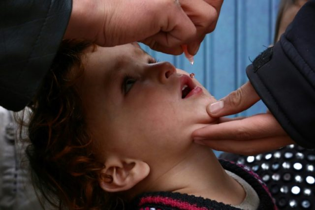 A child is vaccinated against polio, the crippling childhood disease which has been largely eradicated but was feared to have reappeared in Venezuela
