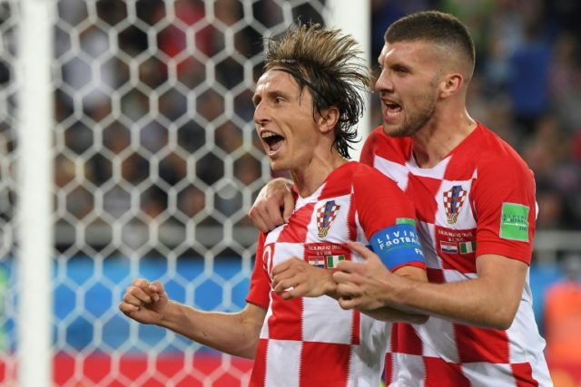 Croatia's midfielder Luka Modric (L) celebrates scoring a penalty with his teammate forward Ante Rebic during the Russia 2018 World Cup Group D football match at the Kaliningrad Stadium in Kaliningrad on June 16, 2018