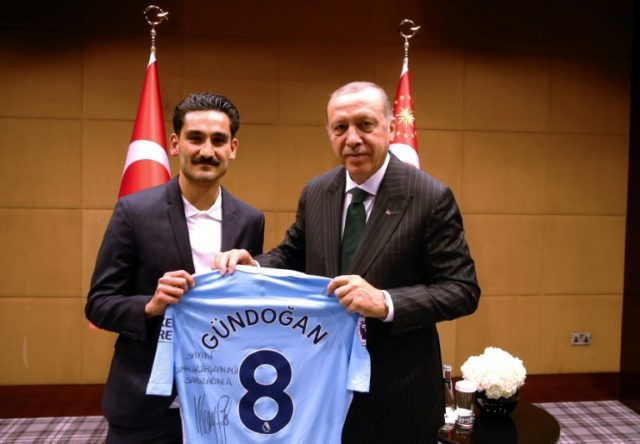 The Turkish Presidential Press office handed out photos showing Recep Tayyip Erdogan posing with Ilkay Gundogan.