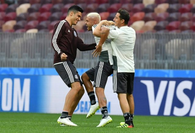 Mexico's players take part in horseplay during a training session at the Luzhniki stadium in Moscow on June 16, 2018, on the eve of their World Cup opener against Germany
