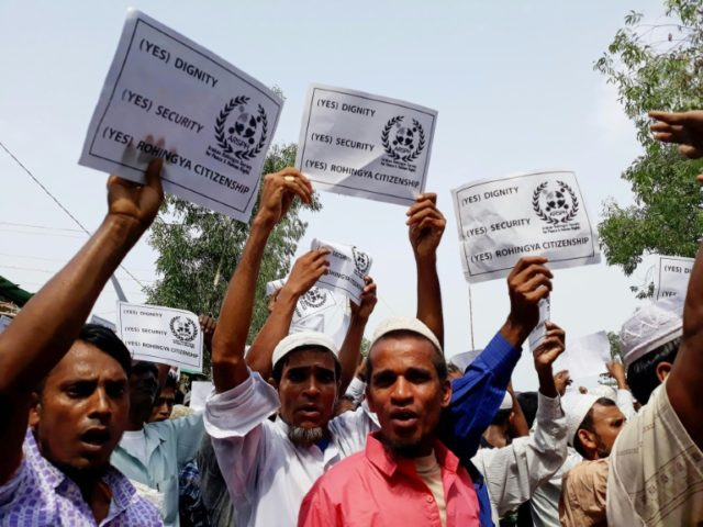 Rohingya refugees stage a demonstration on the day of Eid-ul-Fitr in Kutupalong refugee camp in Cox's Bazar, Bangladesh