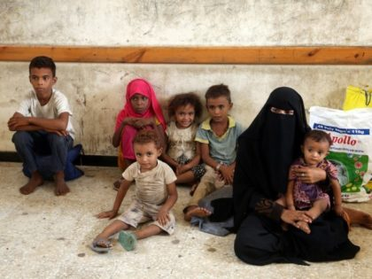 A displaced Yemeni family sit in a classroom of a school in the city of Hodeidah after being evacuated from a village near Hodeidah airport amid battles between government forces and Houthi fighters