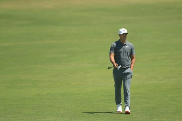 Brooks Koepka of the United States walks up the first green
