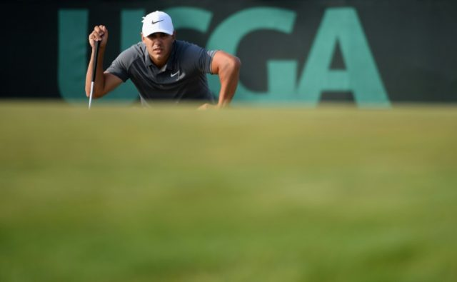 Brooks Koepka of the United States lines up a putt on the 15th green