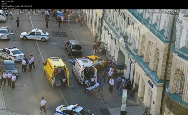 A handout CCTV picture released by the Moscow Municipal Traffic Regulation center shows police officers and paramedics working at the scene after a taxi drove into a crowd injuring seven people