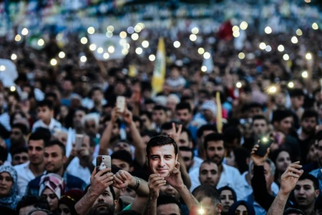 Supporters of imprisoned Selahattin Demirtas, presidential candidate of People's Democratic Party (HDP), hold up the lights of their phones during a rally in Istanbul